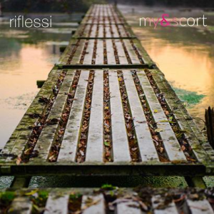 Riflessi - Canzoni in ritardo - My Escort